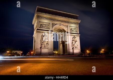 Illuminated Arc de Triomphe in Paris, France - Stock Photo
