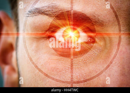 Red laser and reticle on a eye - Stock Photo