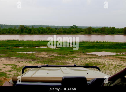 Landscape shot of a river at the Selous Game Reserve in Tanzania (Africa) from within a safari jeep/car - Stock Photo
