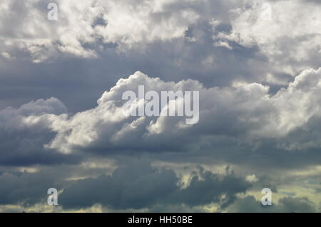Cumulus clouds on a stormy day - Stock Photo