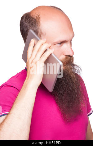portrait of bald bearded man with tablet and pink t-shirt isolated on white background. - Stock Photo
