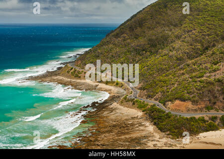 Famous Great Ocean Road winding along the coastline of Victoria. - Stock Photo
