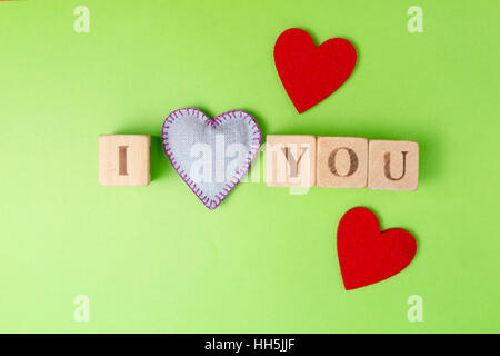 Valentine Hearts Of Jeans And Rustic Alphabet Blocks That Spell Out I Love  You On Greenery