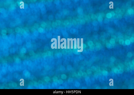 Abstract out of focus blue dots which appear like small bubbles - actually the surface of a ridged piece of textured - Stock Photo
