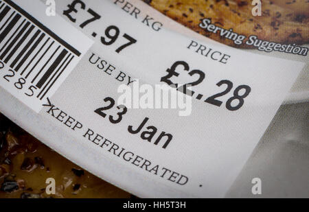 Use by Date label on a packet of fish - Stock Photo