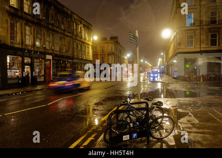 wet rainy night in Finnieston is Scotland's Shoreditch gentrified bad part of town that borders the affluent desirable - Stock Photo
