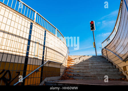 Authentic urban staircase in underground passage with exit to traffic lights in England. - Stock Photo