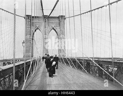 People on the Promenade on Brooklyn Bridge, New York City, USA.