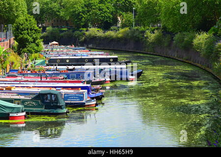 Moored narrow boats on the Grand Union canal - Stock Photo