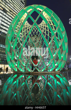 EDITORIAL USE ONLY. Brajesh Kumar, 37 and his son Bhavik Kumar, 4, from London, look at At 7 metres, Ovo, by Ovo - Stock Photo