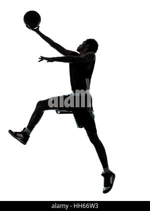 one young man basketball player silhouette in studio isolated on white background stock photo