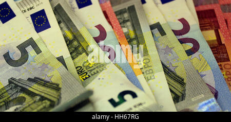 Euro bills and coins - Stock Photo