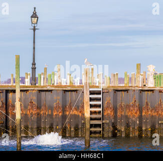 an image of a bubbler, de-icer, circulator, aerator at work in a marina, protecting docks in a marine enviorment - Stock Photo