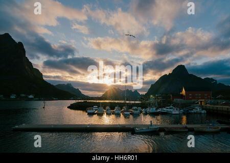 Evening sunset on the harbor of the fishing village of Reine, Moskenes, Lofoten Islands, Norway, Europe - Stock Photo
