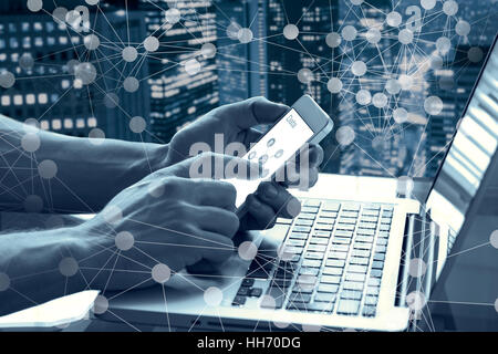 Data and modern technology concept with a person touching a mobile phone screen and using a computer with abstract - Stock Photo