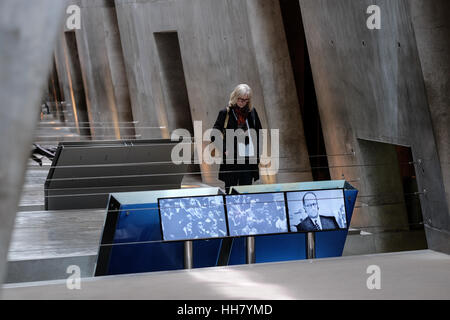 Jerusalem, Israel. 17th January, 2017. A woman touring the Yad Vashem Holocaust Museum stops by a video display. - Stock Photo