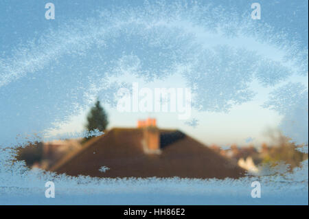 Wimbledon, London, UK. 18th January, 2017. UK Weather. Frost crystals on a roof window with early morning sun striking - Stock Photo