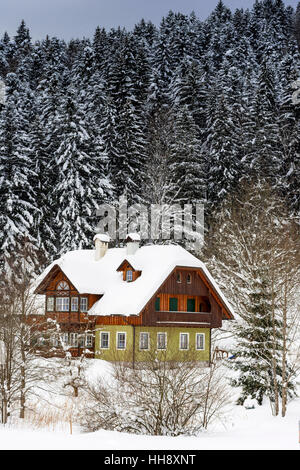 Wooden Mountain House in Winter Forest. Winter Idyll. - Stock Photo