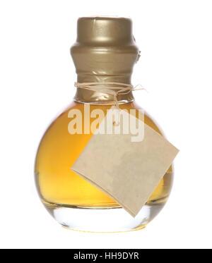 Colourful lemon liquor bottle on isolated white background - Stock Photo