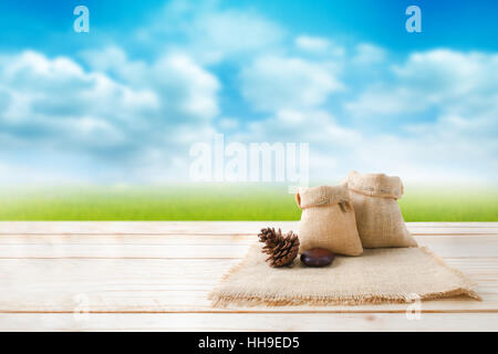 ... Two Of Blank Hemp Sack Bag And Pine Cones On Wood Table Top Floor Over  Blur