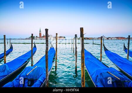 Venice, gondolas or gondole on a blue sunset twilight and San Giorgio Maggiore church landmark on background. Italy, - Stock Photo