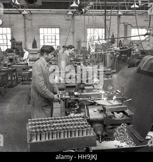 1950s, historical, workers in factory using machines to make steel parts. - Stock Photo