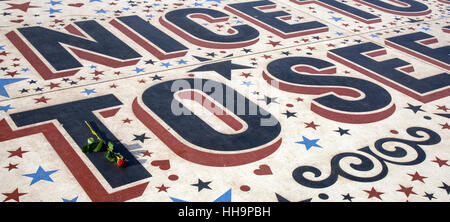 Single red rose on Blackpool''s Comedy carpet Jokes, catch phases, sayings of comic greats, & entertainers at Blackpool, - Stock Photo