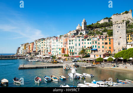 Italy,Liguria,Porto Venere, Panoramic view of the village with the ancient remains,in the foreground the harbor - Stock Photo