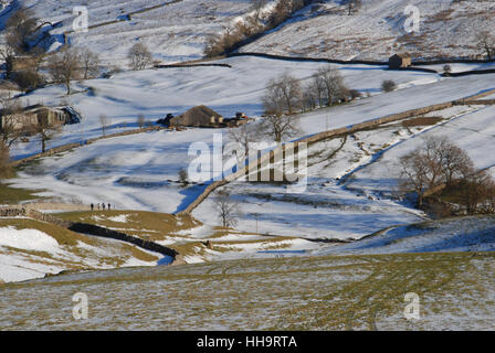 four walkers on a clear winters day in Yorkshire - Stock Photo