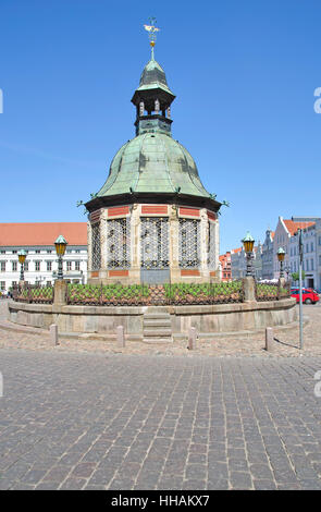 the water art on the marketplace in wismar - Stock Photo