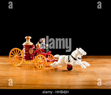 Antique Fire Department Steamer Engine Team Metal Toy - Stock Photo