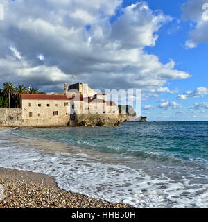 Budva old town and city beach, Montenegro, Europe. Sunset light - Stock Photo
