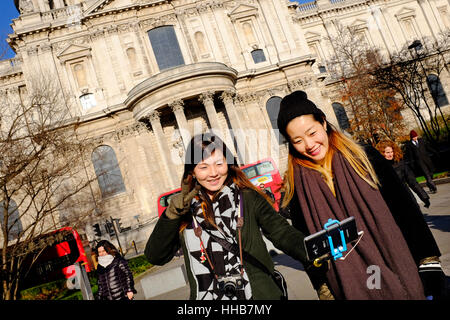 female chinese tourists taking selfie photograph - Stock Photo
