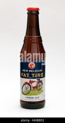 A bottle of Fat Tire amber ale is seen against white background. - Stock Photo