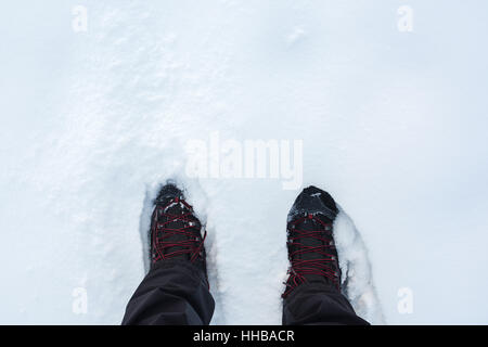 Man in winter boots standing in snow, top view - Stock Photo