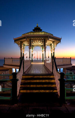 Brighton Victorian bandstand at sunset, also known as birdcage bandstand, the bandstand newly refurbished and is - Stock Photo