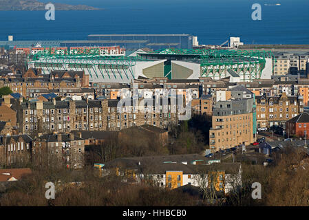 A view of Leith with Hibernian Football Club's ground and the Firth of Forth beyond taken from Salisbury Crags. - Stock Photo