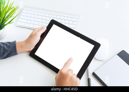 hand using digital tablet finger touch blank screen on desk work table - Stock Photo
