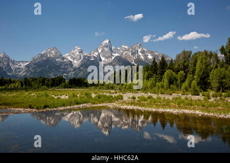WYOMING - The Tetons reflecting in the beaver ponds on the Snake River at Schwabacher Landing in Grand Teton National - Stock Photo