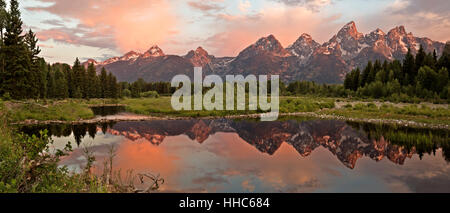 WYOMING - Panoramic image of the Tetons reflecting in a beaver pond on the Snake River at sunrise in Grand Teton - Stock Photo