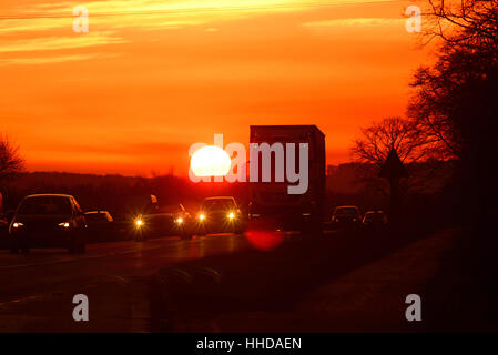 lorry travelling at sunset on the A64 dual carriageway york yorkshire united kingdom - Stock Photo