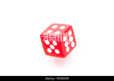 Red dice moving against a white background - Stock Photo