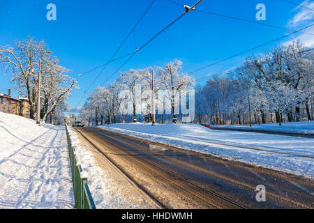 City road covered with fresh white snow after a heavy blizzard in Gdansk, Poland. - Stock Photo