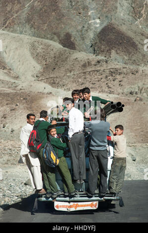 Children overload a local bus to get to school , Gilgit-Baltistan, Pakistan - Stock Photo