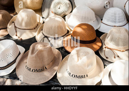 Traditional Panama hats for sale at a street market in Cartagena, Colombia - Stock Photo