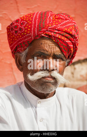 A Rajasthani man wearing a turban and a typically large moustache, Rajasthan, India - Stock Photo