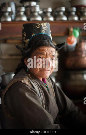 A Ladakhi woman wearing traditional dress, Ladakh, India - Stock Photo