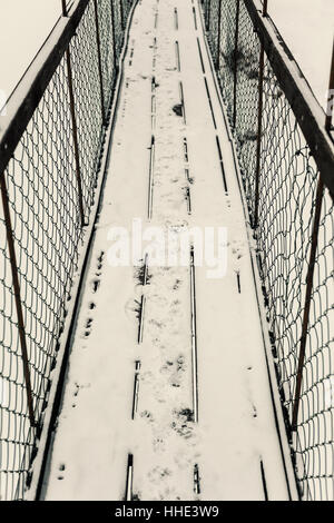 Abstract composition of an old suspension bridge, mountain winter area. - Stock Photo
