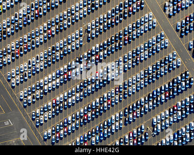 Aerial view of a car distribution centre, new cars parked in rows on a lot ready for sale. - Stock Photo