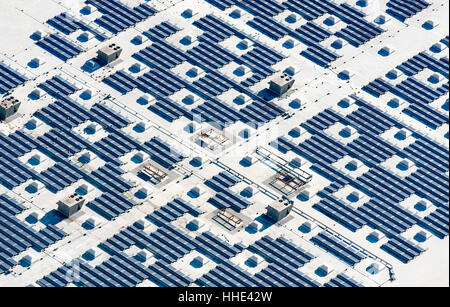 Aerial view of a solar farm, blue photovoltaic solar panels set out in a grid pattern. - Stock Photo